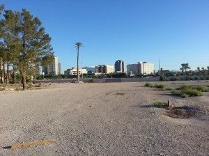 Vacant land in the middle of the block, encircled by property walls.