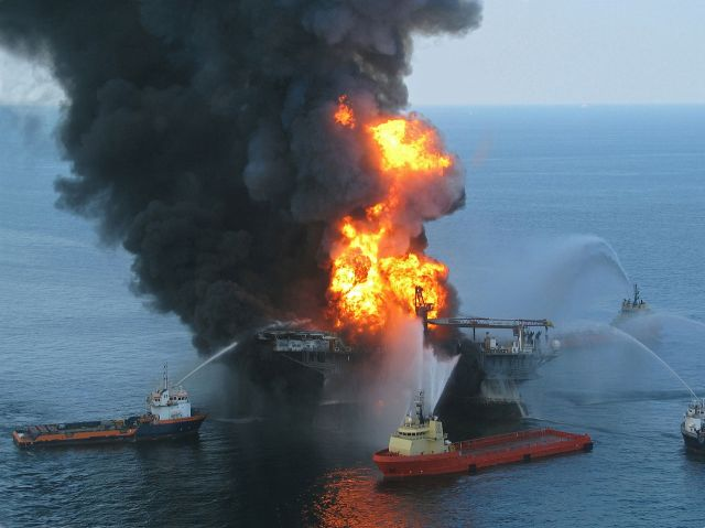 Supply vessels battle the blazing remnants of the off shore oil rig Deepwater Horizon, April 2010. Source: U.S. Coast Guard.