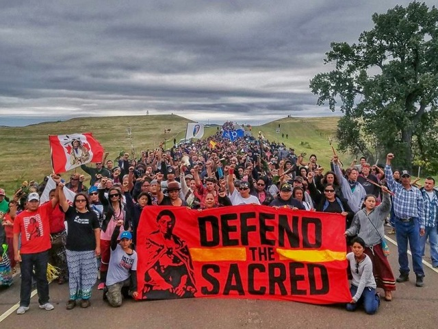 Prayer march to a site where Native American burial sites were dug up by bulldozers used to dig an oil pipeline