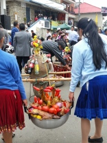 Indigenous women in Ecuador carrying offerings to religious icons and idols (Catholic saints etc.)