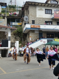 Indigenous dances being performed for a Catholic religious festival, outside the Church of Turi, above Cuenca valley
